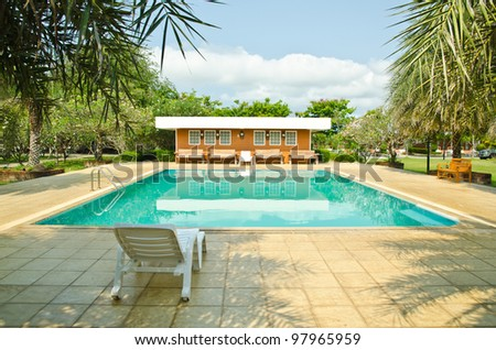 Swimming pool at hotel in thailand - stock photo