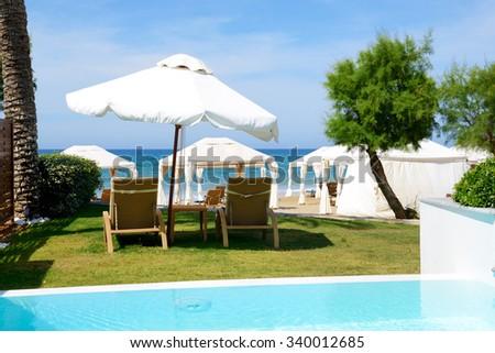 Swimming pool at luxury villa and beach, Crete, Greece - stock photo