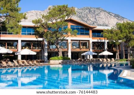 Swimming pool at mediterranean summer resort hotel in Turkey - stock photo