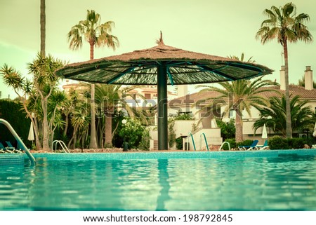 swimming pool at morning . vintage color toned image  - stock photo