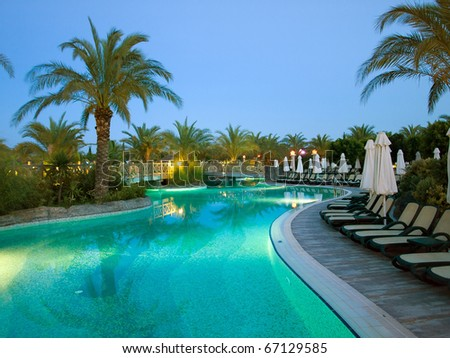 Swimming pool at night in France. Wide angle. - stock photo