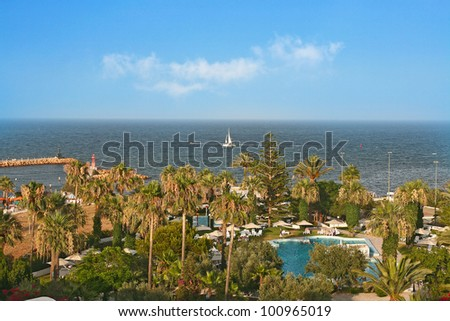 Swimming pool at the beach of hotel, Tunisia - stock photo
