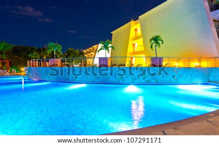 Swimming pool at the evening (night) time  in mexican resort . - stock photo