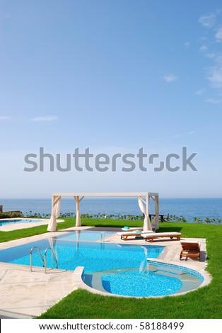 Swimming pool at the modern luxury villa, Crete, Greece - stock photo