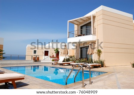 Swimming pool at the modern luxury villa, Crete, Greece - stock photo