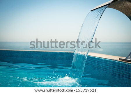 Swimming pool at the sea - stock photo