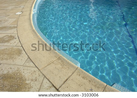 swimming pool blue water in a summer day