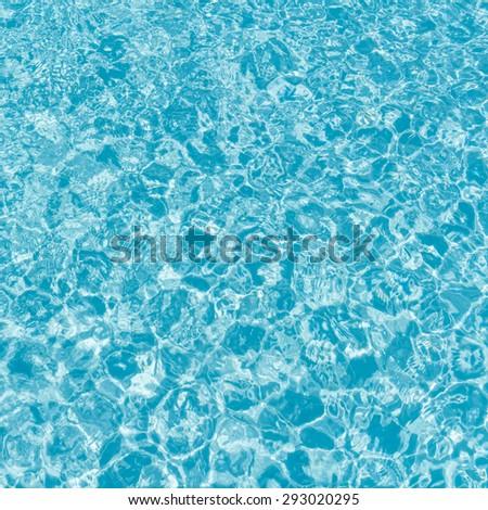Swimming pool blur water background. - stock photo