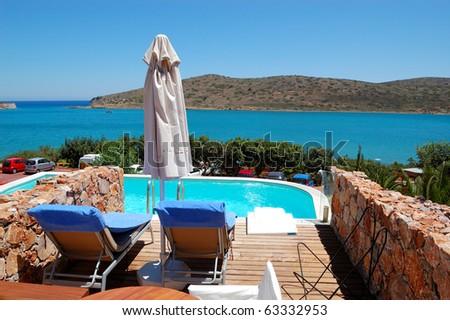 Swimming pool by luxury villa, Crete, Greece - stock photo