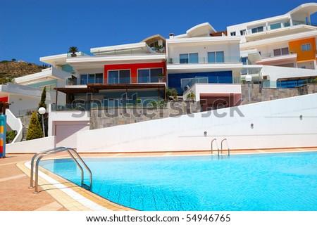 Swimming pool by luxury villas, Crete, Greece - stock photo