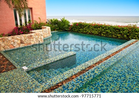 Swimming Pool by the sea. - stock photo