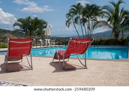Swimming pool chairs in a relaxing setting