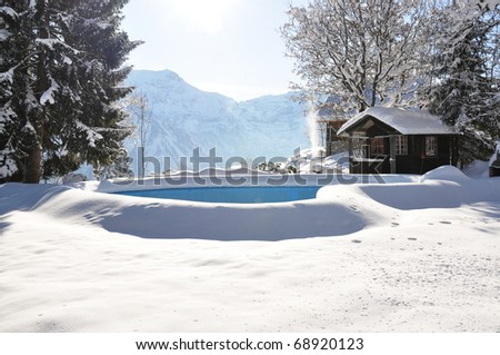 Swimming pool covered with snow - stock photo