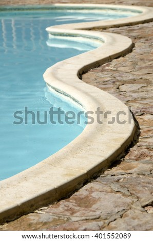 swimming pool detail with blue water - stock photo