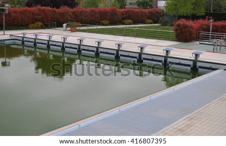 Swimming pool for sport competitions with diving boards