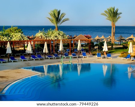 Swimming pool in a luxury resort in the morning. - stock photo