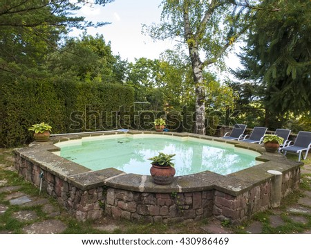 Swimming pool in a rural country house - stock photo