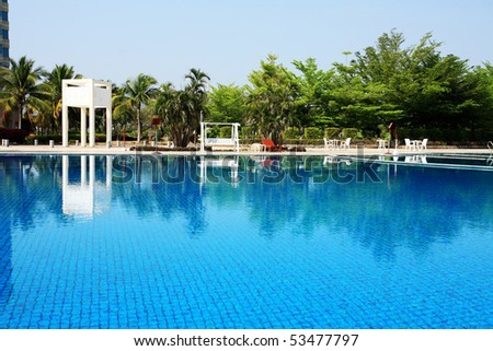 swimming pool in china hotel with palm trees. china,Sanya