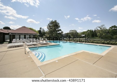 Swimming pool in condominium complex - stock photo