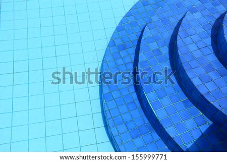 Swimming pool in curved shape with stairs - stock photo