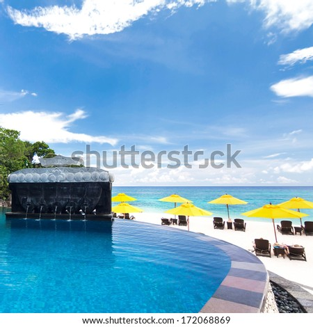 Swimming pool in luxury resort - stock photo