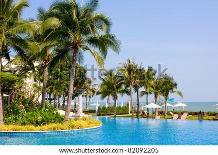 Swimming pool in luxury resort near the sea - stock photo