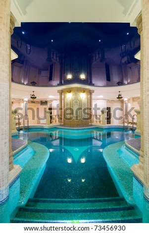 swimming pool in modern hotel - stock photo
