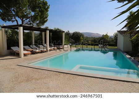 Swimming pool in open air and relax seats - stock photo