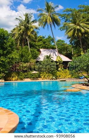 Swimming pool in spa resort . Thailand . - stock photo