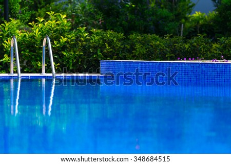 Swimming pool in the garden - stock photo