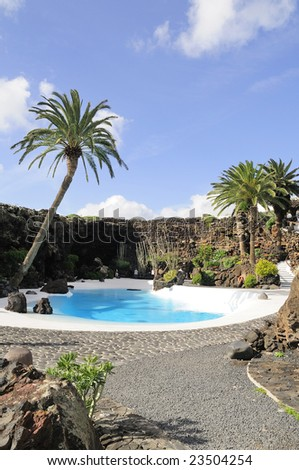 Swimming pool in the Jameos del Agua by Casar Manrique. Lanzarote. Canary Islands. Spain - stock photo
