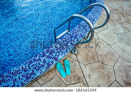 Swimming pool in the resort. View from water - stock photo