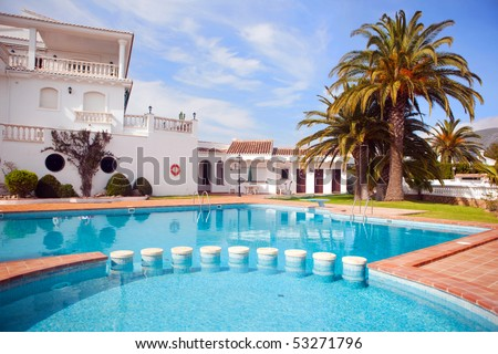Swimming pool in tropical garden - stock photo