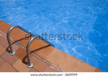 swimming pool ladder - stock photo