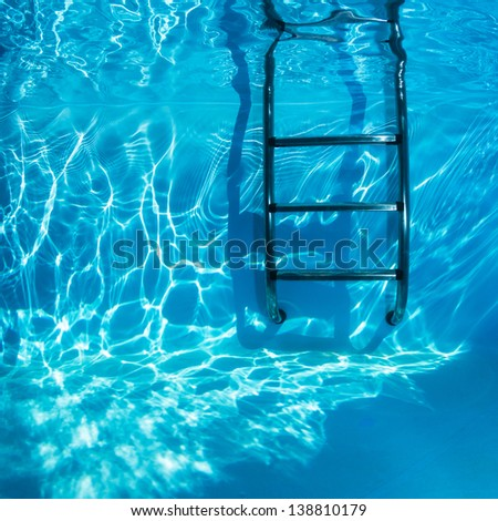 Swimming pool Ladders Underwater in a clear freshwater. - stock photo