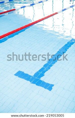 Swimming pool lanes with bottom lane line and ropes - stock photo