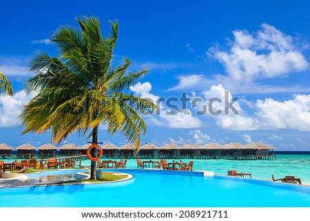 swimming pool near the beach, vacation concept - stock photo