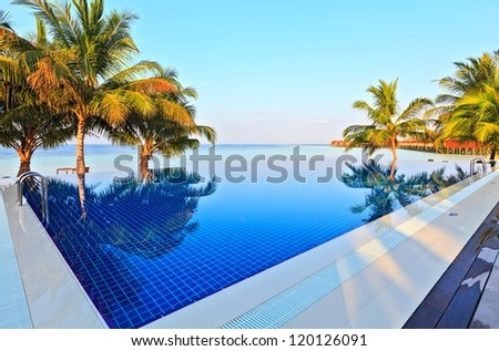 Swimming pool near the Indian Ocean, Maldives - stock photo