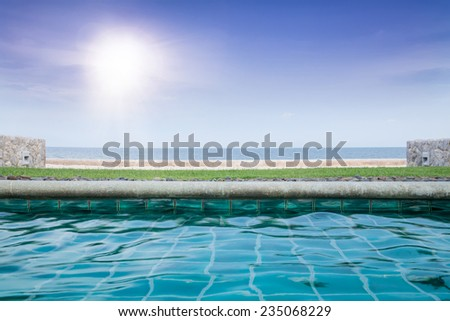 Swimming Pool Near the Sea with Sunlight - stock photo