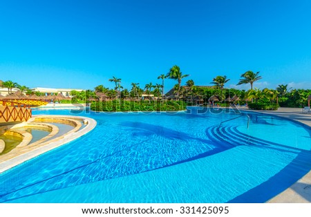 Swimming pool of a  luxury tropical caribbean resort, hotel. - stock photo