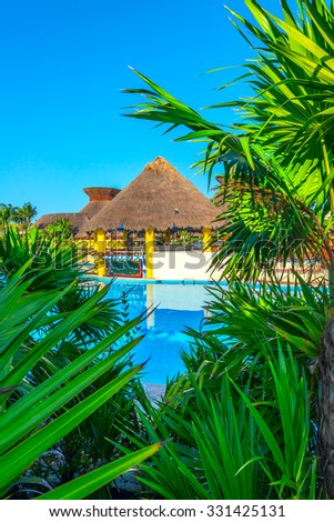 Swimming pool of a  luxury tropical caribbean resort, hotel. Vertical.