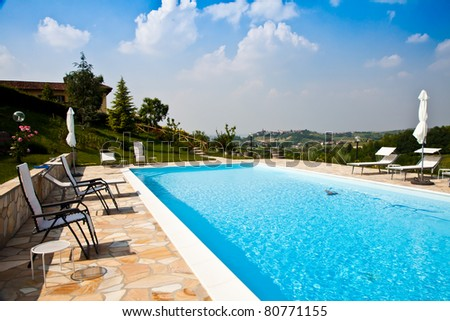 Swimming pool of an Italian beauty farm in the middle vineyards, Monferrato area, Piemonte region.