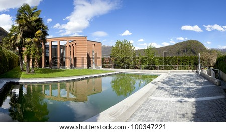 Swimming pool of design home - stock photo