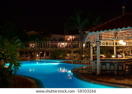 Swimming pool of luxury hotel at night. Tenerife, Canary Islands, Spain. - stock photo