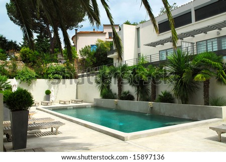 Swimming pool of mediterranean villa in French Riviera - stock photo
