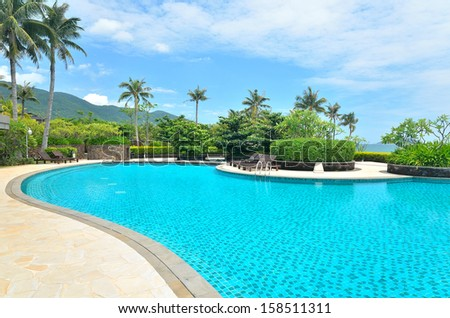 Swimming pool of tropical resort hotel - stock photo