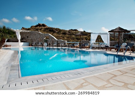 swimming pool on hotel in a island the summer with a beautiful sky - stock photo
