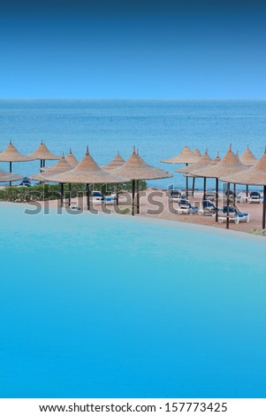 swimming pool on the beach - stock photo