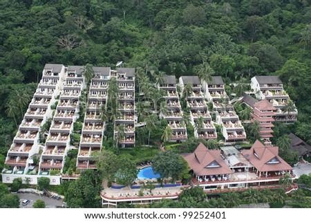 Swimming pool, open-air restaurant and beach of luxury hotel, Phuket island, Thailand - stock photo