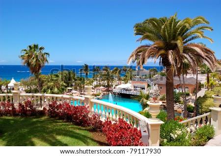 Swimming pool, open-air restaurant and beach of luxury hotel, Tenerife island, Spain - stock photo